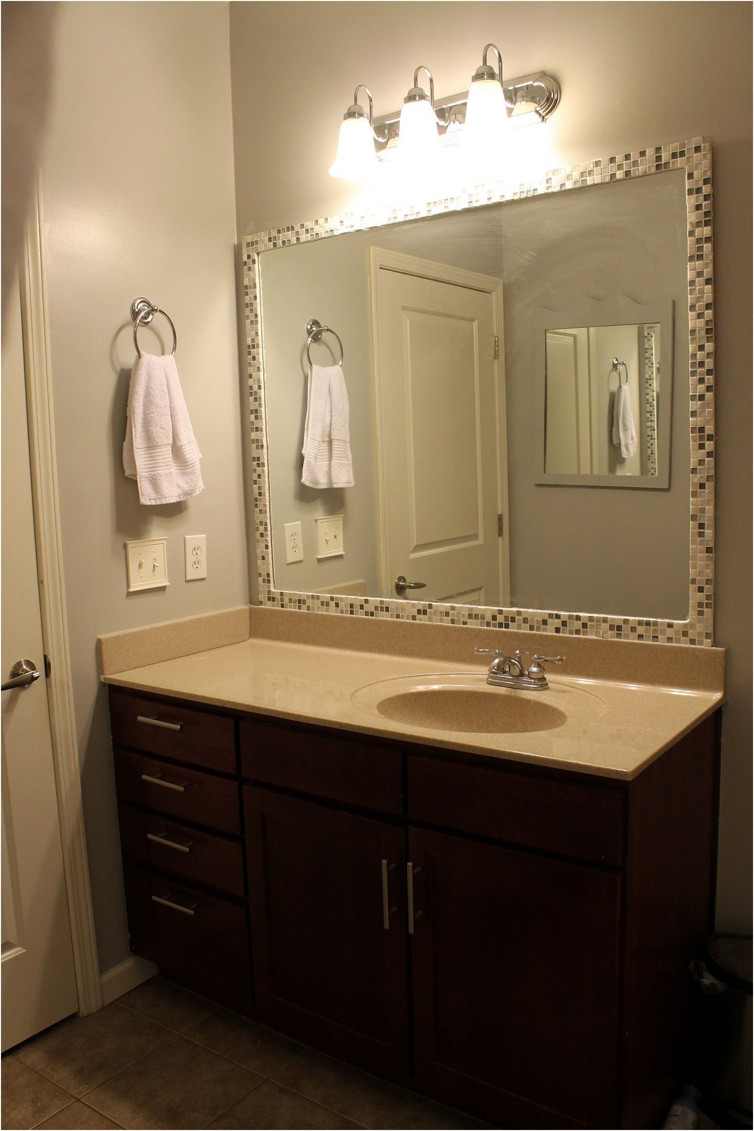 Elegant Framing Large Mirror In Bathroom