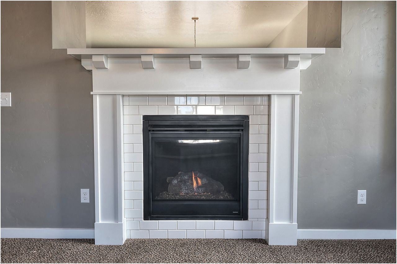 Tile Fireplace Surround Ideas Elegant Cozy Up to This Fireplace Surrounded with White Subway Tile